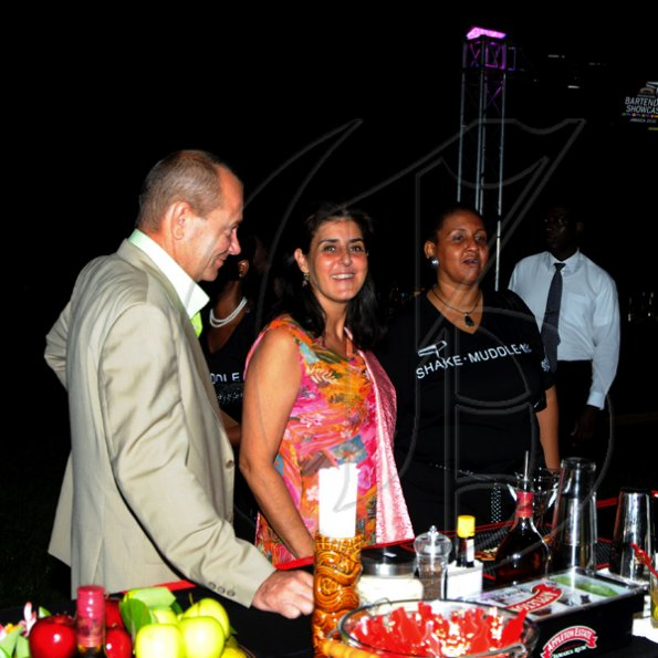 Winston Sill / Freelance Photographer Appleton Estate Jamaica Rum International Bartender Showcase 2010, held at in the Sunken Garden at Hope Gardens, Old Hope Road on Friday night October 22, 2010. Here are Greta Bogues (right); the new Spanish Ambassador (centre) and her husband (left).