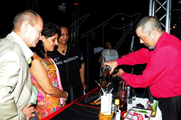 Winston Sill / Freelance Photographer Appleton Estate Jamaica Rum International Bartender Showcase 2010, held at in the Sunken Garden at Hope Gardens, Old Hope Road on Friday night October 22, 2010. Here are the new Spaniosh Ambassador (second left) and her husband (left); Greta Bogues (third left); and Francisco Bretau (right) of Spain.