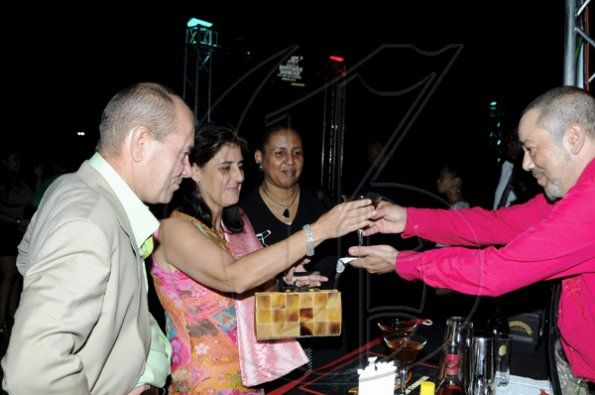 Winston Sill / Freelance Photographer The new Spanish Ambassador Celsa Nuno (second left), and her husband Alex Crowther (left); Greta Bogues (third left); get a drink from  Francisco Bretau of Spain.   ****************************************************************************************************Appleton Estate Jamaica Rum International Bartender Showcase 2010, held at in the Sunken Garden at Hope Gardens, Old Hope Road on Friday night October 22, 2010. Here are the new Spanish Ambassador (second left), and her husband (left); Greta Bogues (third left); and  Francisco Bretau (right) of Spain.