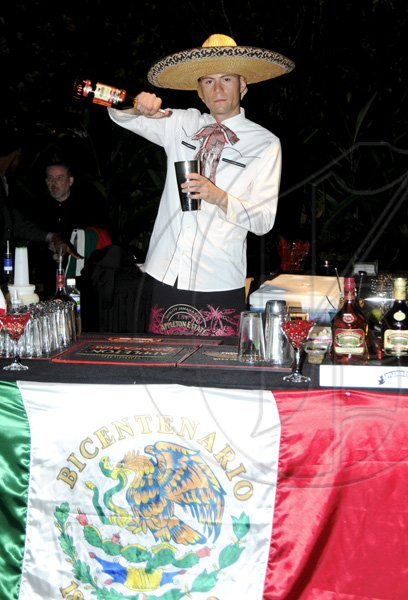 Winston Sill / Freelance Photographer Carlos Morelos of Mexico does his thing   ***************************************************************.Appleton Estate Jamaica Rum International Bartender Showcase 2010, held at in the Sunken Garden at Hope Gardens, Old Hope Road on Friday night October 22, 2010. Here is Carlos Morelos of Mexico.
