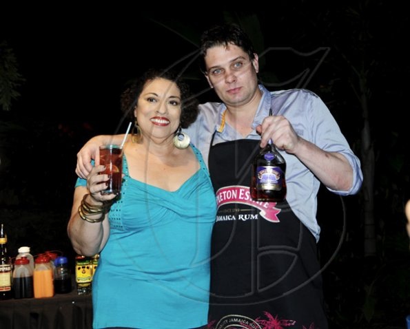 Winston Sill / Freelance Photographer Joy Spence and Jamie Lawton of New Zealand .pose for the camera.  ****************************************Appleton Estate Jamaica Rum International Bartender Showcase 2010, held at in the Sunken Garden at Hope Gardens, Old Hope Road on Friday night October 22, 2010. Here are Joy Spence (left);and Jamie Lawton (right) of New Zealand (right).