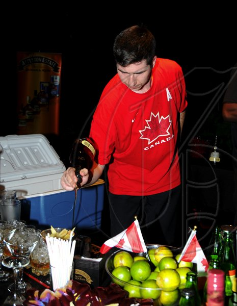 Winston Sill / Freelance Photographer Appleton Estate Jamaica Rum International Bartender Showcase 2010, held at in the Sunken Garden at Hope Gardens, Old Hope Road on Friday night October 22, 2010. Here is Gerry Jobe of Canada.