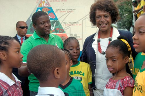 Ricardo Makyn/Staff Photographer.Principal of the Craighton Primary School Fabian Mahabeer  in the Red Light District in Rural St Andrew with United States Ambassador to Jamaica Pamela Bridgewater with Children from the School at the Schools Jamaica Day on Friday 25.2.2011.