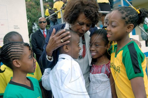 Ricardo Makyn/Staff Photographer.Students of the  Craighton Primary School  in the Red Light District in Rural St Andrew with United States Ambassador to Jamaica Pamela Bridgewater at the Schools Jamaica Day on Friday 25.2.2011.