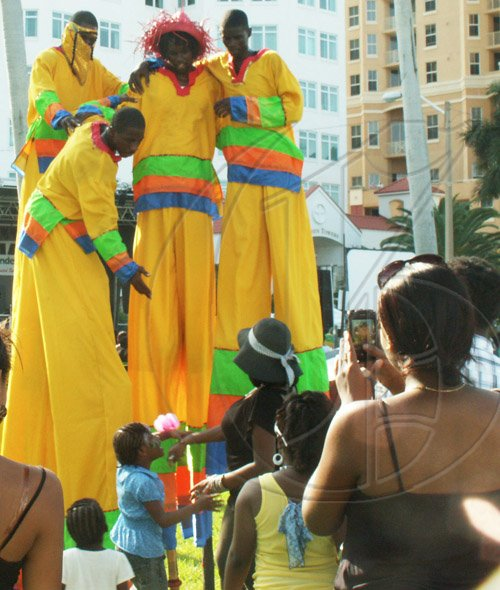 Contributed Mokojombie stilt dancers at Jamaica Independence celebration at Palm Beach Post Park.