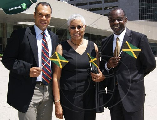 Contributed                                                                                                                                                                                                                                                          Deputy Chief of Toronto Police Service, Peter Sloly (left); President of the Project for the Advancement of Childhood Education (PACE) Canada, Mary Anne Chambers; and Consul at the Jamaican Consulate General in Toronto, Nigel Smith, proudly display miniature Jamaican flags at a flag raising ceremony held on August 1 at Nathan Phillips Square, Toronto City Hall, to commemorate Jamaica's Independence.