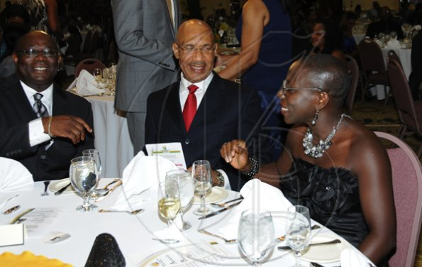 Winston Sill / Freelance Photographer Jamaica Exporters Association (JEA) Awards Banquet, held at the Wyndham Hotel  on  Wednesday night June 29, 2011. Here are Vitus Evans (left), President, JEA; Governor General Sir Patrick Allen (centre); and Brenda Leon (right).