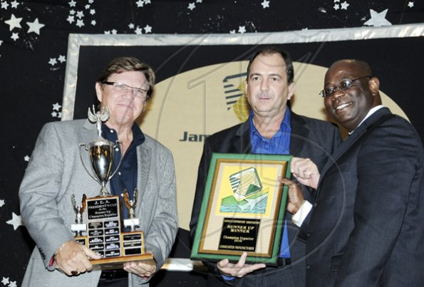 Winston Sill / Freelance Photographer Jamaica  Exporters Assocaition (JEA) Awards Banquet, held at the Wyndham Hotel  on Wednesday night June 29, 2011. Here Vitus Evans (right) presents the runner-up to the Champion Exporters Trophy to Ian Garbutt (left), Managing Director, and Chris Boorman (centre), Director,  of Associated Manufacturing Company Limited.