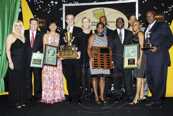 Winston Sill / Freelance Photographer Jamaica Exporters Association (JEA) Awards Banquet, held at the Wyndham Hotel  on Wednesday night June 29, 2011. Here Vitus Evans (fourth right), President, JEA; and Allan Barnes (fourth left) pose with members of Red Stripe team.