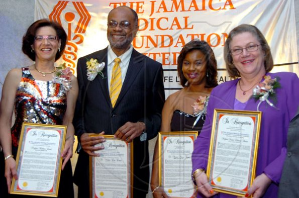 Rudolph Brown/Chief Photographer Doctors Honoured by the Jamaica Medical Foundation from left Professor Kathleen Coard, Dr. Winston Dawes, Dr. Minerva Marcia Thame and Professor Denise Eldemire-Shearer, at the Jamaica Medical Foundation awards and fund-raising banquet at the Hilton Hotel in New Kingston on Saturday, March 21-2009