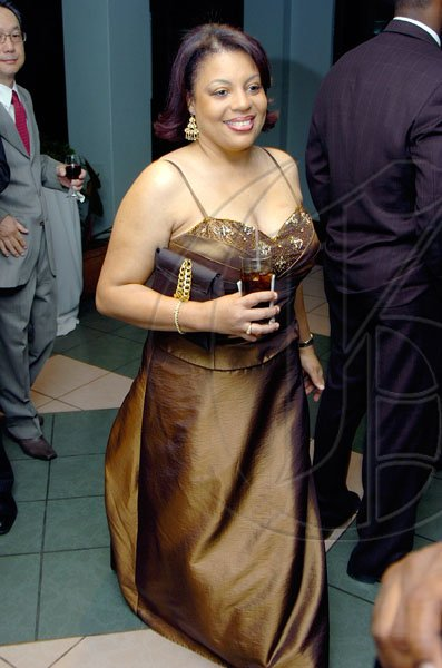 Rudolph Brown/Chief Photographer Sandra Letts, Marketing Manager of Advantage General Insurance arrive at the Jamaica Medical Foundation awards and fund-raising banquet at the Hilton Hotel in New Kingston on Saturday, March 21-2009