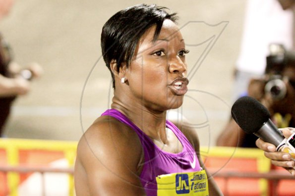 Anthony Minott/Freelance Photographer The USA's Carmelita Jeter speaks with reporters after winning the women's 100m in 10.94 seconds during the Jamaica National International Invitational athletics meet at the National Stadium, Kingston, on Saturday, May 1, 2010
