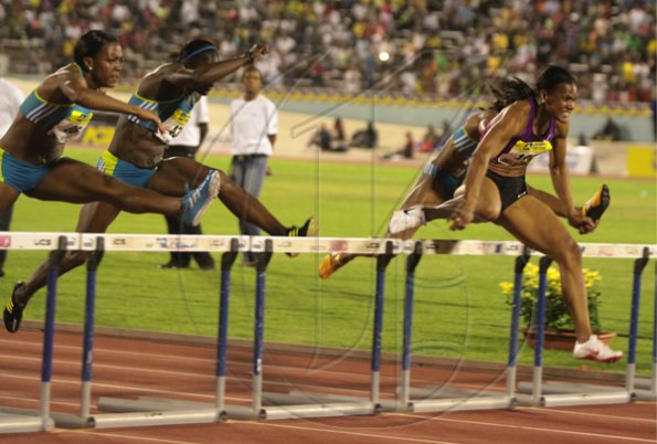 Anthony Minott/Freelance Photographer USA's Gennie Powell (right) powers to victory in 12.72 seconds in the women's 100m hurdles race during the Jamaica National International Invitational athletics meet at the National Stadium, Kingston, on Saturday, May 1, 2010.