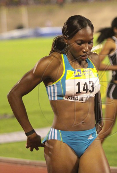 Anthony Minott/Freelance Photographer Jamaica's Novlene Williams-Millls walks away after winning the women;s 400m event in 50.32 seconds race during the Jamaica National International Invitational athletics meet at the National Stadium, Kingston, on Saturday, May 1, 2010.