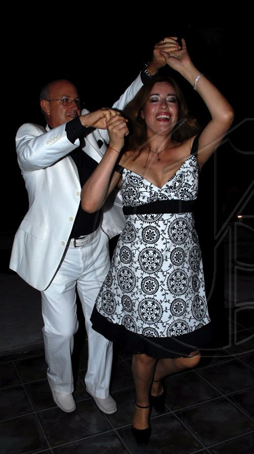 Colin Hamilton/Freelance Photographer Isidro Fernandez-Aballi and wife Viviana having a whale of a time on the dance floor during the Latin American Women's Club wine and cheese reception held at Kenny Benjamin resident on Friday, September 25, 2009.