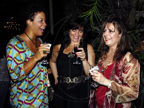 The girls from left to right: Debbie Salmon, Rosa Joseph and Leila Younis out and having fun at the wine and cheese reception, in Stony Hill, St Andrew..