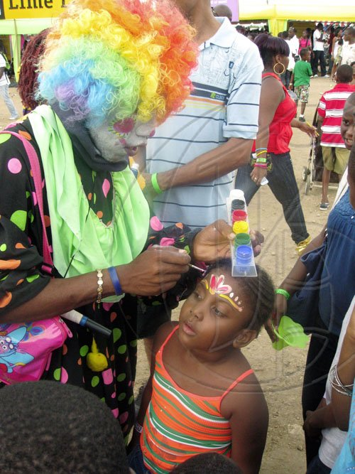 Mel Cooke photo  The clown painted many happy faces at Skool Aid.