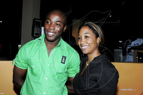 LIME's Events Manager, Nathaniel Palmer takes a photo op with Theresa Lindo at the launch of the LIME Cup Match Play-Off Golf Tournament at Cuddy'z.  Winston Sill / Freelance Photographer Launch of LIME Cup Match Play-Off Golf Tournament, held at Cuddy'z, Dominica Drive, New Kingston on Tuesday night September 28, 2010.