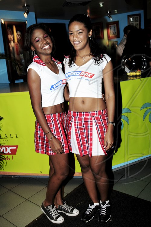 The very pleasant hostesses for the evening, Philicia Williams (left) and Kayla Mendes greeted guests as they attended the launch of the LIME Cup Match Play-Off Golf Tournament  Winston Sill / Freelance Photographer Launch of LIME Cup Match Play-Off Golf Tournament, held at Cuddy'z, Dominica Drive, New Kingston on Tuesday night September 28, 2010.
