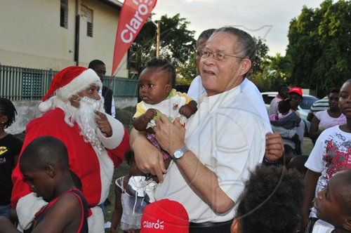 JIS The baby has attracted the attention of both Prime Minister, the Hon. Bruce Golding, and Santa Claus at the Prime Minister's annual West Kingston Christmas Treat at the Tivoli Gardens Community Centre in Kingston on Saturday, December 18. Mr. Golding treated children and their parents at several locations including Tivoli, Fletcher's Land and Denham Town.