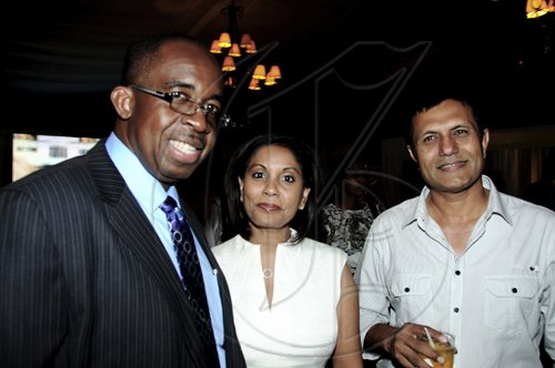 Winston Sill / Freelance PhotographerGroup Managing Director of National Commercial Bank (NCB) Patrick Hylton (left) and the bank's Assistant General Manager, Retail Banking Bernadette Barrow lyme with Carland Investments Managing Director Tariq Malik at the NCB Auto Dealers Awards Ceremony, held at Terra Nova All-Suite Hotel, Waterloo Road on Tuesday night.*************************************************************************** April 5, 2011.