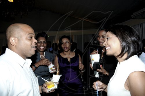 Winston Sill / Freelance PhotographerAn animated Steve Austin of Stewart's Auto Sales has the attention of NCB executives (from second left) Audrey McIntosh, Donna-Marie Sutherland, Audrey Tugwell-Henry and Bernadette Barrow.********************************************************************National Commercial Bank (NCB) Auto Dealers Awards Ceremony, held at Terra Nova All-Suite Hotel, Waterloo Road on Tuesday night April 5, 2011.