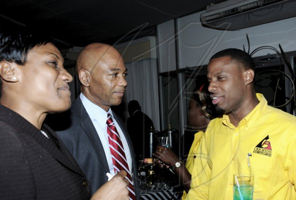 Winston Sill / Freelance PhotographerJermaine Blair (right) loans co-ordinator at Crichton Automotive, raps with Dennis Cohen, deputy group managing director of National Commercial Bank and Audrey Tugwell-Henry, senior general manager, Retail Banking at NCB.************************************************************* Auto Dealers Awards Ceremony, held at Terra Nova All-Suite Hotel, Waterloo Road on Tuesday night April 5, 2011.