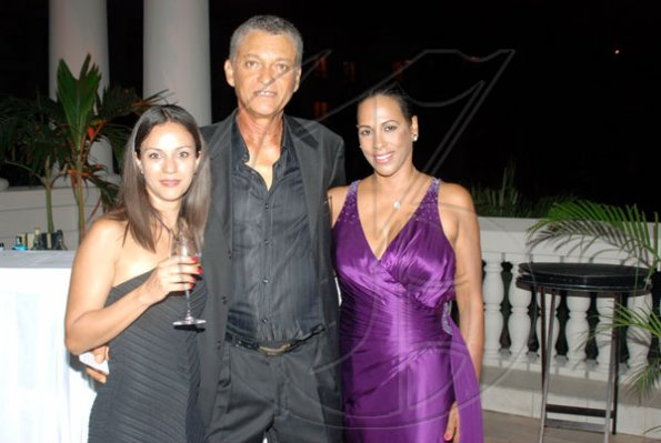 Janet Silvera Photo   Some men have all the luck, Richard Russell (centre) is flanked by two beauties Tanya Allgrove (left) and Sophia Max Brown at the Jamaica Committee Pineapple Ball at the Ritz Carlton Rose Hall in Montego Bay last Saturday night.