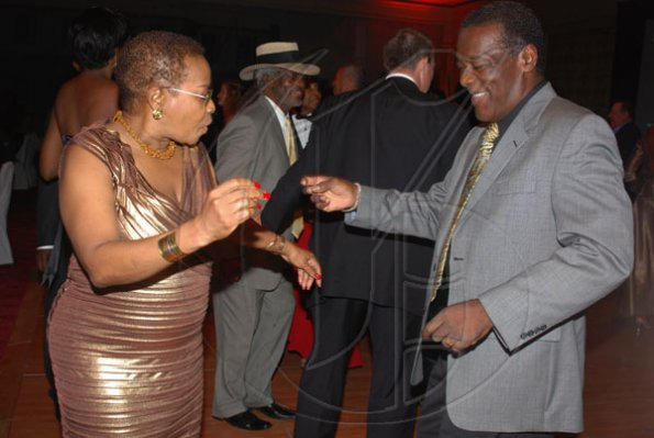 Janet Silvera Photo   The Gleaner's Corporate Affairs manager, Karin Cooper and husband Howard showed they knew a thing or two about the contemporary dance moves at the Pineapple Ball at the Ritz Carlton Rose Hall last Saturday night.