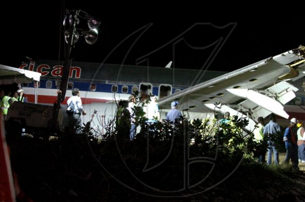 Winston Sill / Freelance Photographer Removal of crash American Airlines aircraft from the crash site, off Port Royal Road, on Monday night December 28, 2009. Winston Sill / Freelance Photographer Removal of the middle section of the  crashed  American Airlines aircraft from the crash site, off Port Royal Road, on Monday night December 28, 2009.