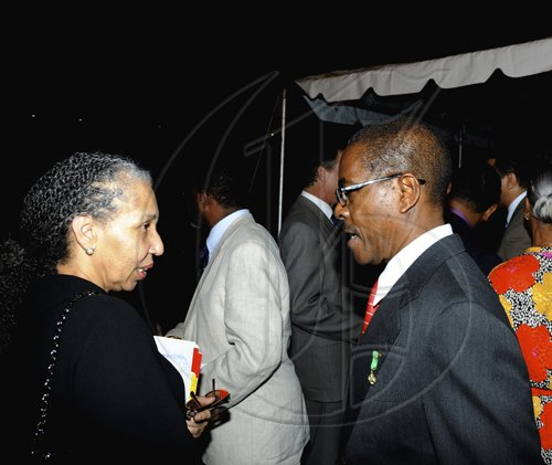 Winston Sill / Freelance Photographer ustice Hillary Phillips (left) and Justice Seymour Panton in conversation.  ***************************************************************** (right).Prime Minister Bruce Golding host ceremony for the presentation of Prime Minister's Medal of Appreciation for Service to Education, held at Jamaica House on Thursday night May 12, 2011. Here are Justice Hillary Phillips (left); and Justice Seymour Panton (right).