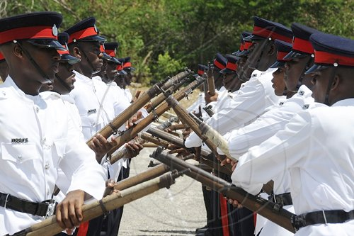 Ian Allen/Photographer The latest batch of Jamaica Constabulary Force graduates participate in a passing-out parade at the Jamaica Police Academy in Twickenham Park,  St Catherine yesterday.