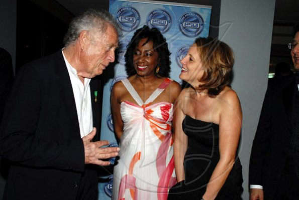 Private Sector Organisation of Jamaica (PSOJ) Hall of Fame inductee Chris Blackwell is greeted by Sandra Glasgow (centre), CEO of the PSOJ and Tracy Matalon, wife of PSOJ President Joseph Matalon, on his arrival for last night's ceremony at the Hilton Kingston Hotel in New Kingston. Blackwell, the founder and chairman of Island Outpost, has been involved in the entertainment and tourism industry for more than 40 years.
