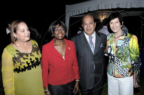 Winston Sill / Freelance Photographer Hosts of the party Diane (left and Gordon Tewani with special guests Lorna Golding (second left) and Ambassador Sue Cobb.  ********************************************************************************American Friends of Jamaica (AFJ) recepotion, held at Hill Road, Norbrook on Monday April 11, 2011.