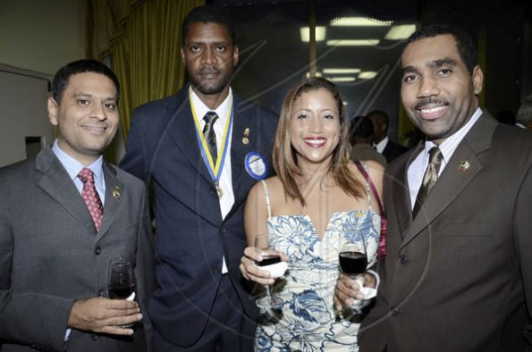 Rudolph Brown/Photographer Christy Almeida (second right), is flanked by Haresh Ramchandani, Donovan G. Brown, and Audley Knight at  The Rotary Club of St Andrew North's 25th annual installation ceremony at the Wyndham Hotel in New Kingston on Monday, June 27, 2011.