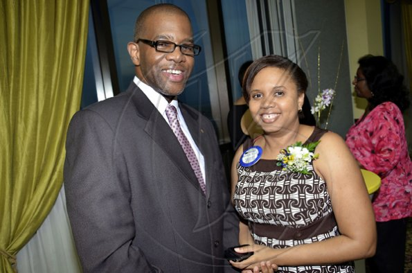 Rudolph Brown/Photographer Gilroy Graham (left) and Marcelle Smart at The Rotary Club of St. Andrew North's 25th annual installation ceremony at the Wyndham Hotel in New Kingston on Monday, June 27, 2011.