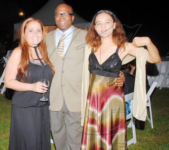 Janet Silvera Photo   From left: Rotarians Ximena Monteith, Neville Scott and Charmaine McIntosh pose for social pages.  ****************************************************************** at the installation banquet and charter ceremony of the Rotary Club of Rose Hall at the Rose Hall Great House last Friday night.