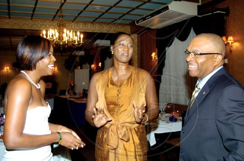 Winston Sill / Freelance Photographer  Yahneake Sterling (from left), President of the Rotaract Club of Liguanea Plains, guest speaker Grace Jackson, and Rotarian Trevor Riley share a laugh before the proceedings.      **************************************  Rotaract Club of Liguanea Plains, Installation and Awards Ceremony, held at Hotel Four Seasons, Ruthven Road on Friday night July 30, 2010.