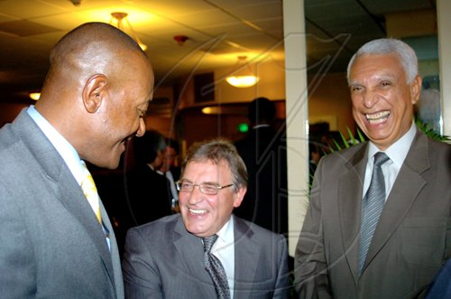 Winston Sill / Freelance Photographer Russian Ambassador Victor Zotin (centre) shares a hearty laugh with Dr Ronald Robinson (left) state minister for Foreign Affairs and Foreign Trade; and Colombian Ambassador Emilio Ventura Diaz Mejia.   ******************************************************************************* host Reception to celebrate the 35th Anniversary of Diplomatic Ties between Jamaica and Russia, held at the Jamaica Pegasus Hotel, New Kingston on Tuesday March 16, 2010.
