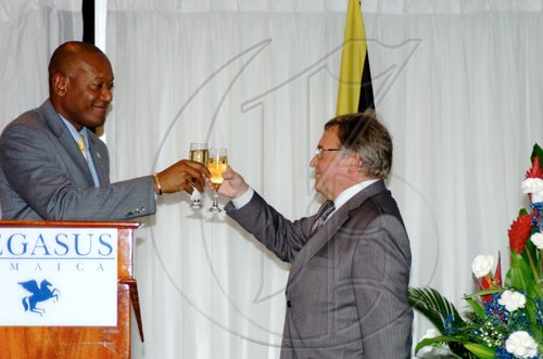 Winston Sill / Freelance Photographer LEAD PHOTO State Minister for Foreign Affairs and Foreign Trade Dr Ronald Robinson (left) toasts the continued good relations between Jamaica and Russia with Russian Ambassador Victor Zotin.  ***************************************************************** host Reception to celebrate the 35th Anniversary of Diplomatic Ties between Jamaica and Russia, held at the Jamaica Pegasus Hotel, New Kingston on Tuesday March 16, 2010.