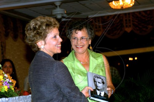 "Winston Sill / Freelance Photographer Carla Seaga (left), wife of former Prime Minister Edward Seaga, presents a copy of her husband's book to Dr Fay Whitbourne-Morrison at the launch.  *****************************************************************   Launch of Edward Seaga book- ""My Life And Leadership, volume one: Clash of Ideologies,1930--1980"", held at Mona Visitor's Lodge, UWI Campus on Wednesday March 3 , 2010. Here"