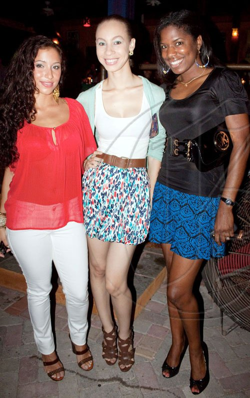 Major style points awarded to (from left) College Lifestyle TV host, Christina Benjamin and fashion designers Camesha Powell and Keneea Linton for their chic head-to-toe looks at Red Bones Blues Café last Friday.