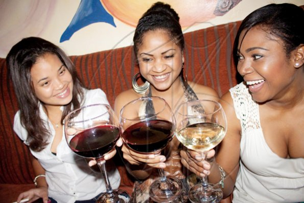 """Who does not love wine, women and song, remains a fool his whole life long"". As they raise a toast to Tanya Stephens' performance at Christophers, (from left) Antoinette Pinnock, Charlette Chantiloupe and Martina Moyston bring credence to the classic verse."