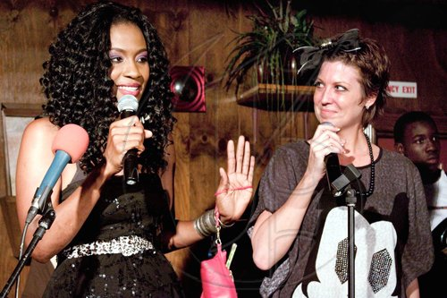 Italee Watson (left) and Carrie 'Quizz' Sigurdson take the stage at Village Blues Bar for   'Italee, Quizz & Friends', a new weekly liuve music series to be held every Tuesday at the venue. The first edition saw performances from Tami Chynn, Chino, Gabriel, Juss Ice and Singing Sweet.