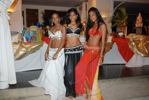 Janet Silvera Photo   Beauties of Shambala belly dancers from left, Amandah Spence, Shameika Dalley and Toni Spence.  **************************************************************************** at the Hanover Charities annual Sugar Cane Ball at the Round Hill Hotel last Saturday night.