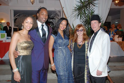 Janet Silvera Photo   From left: Stephanie Lyle-Brown, Lennox Lewis and wife Violet pose with woman who dresses so many, Nicole Miller and husband, Kim Taitpale.  ****************************************************************************** at the Hanover Charities Sugar Cane Ball at the Round Hill Hotel and Villas last Saturday night.