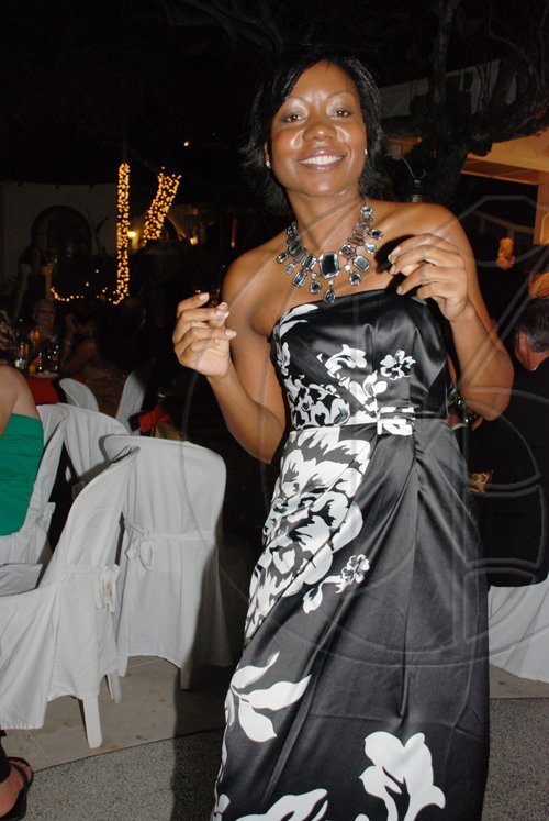 Janet Silvera Photo   Cardiologist Claudine Lewis has a 'heart' for all her patients, and a passion for music. Here she dances to every beat at the Hanover Charities Sugar Cane Ball.     at the Round Hill Hotel and Villas last Saturday night.
