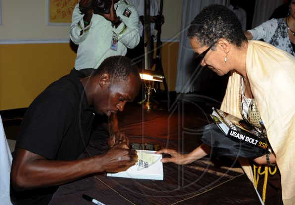"Winston Sill / Freelance Photographer Launch and book signing of Usain Bolt book, ""My Story 9.58-- Being The World,s Fastest Man"", held at the Terra Nova All-Suite Hotel, Waterloo Road on Thursday night October 21, 2010. Here are Bolt signs Fay Ellington's copy of his book."
