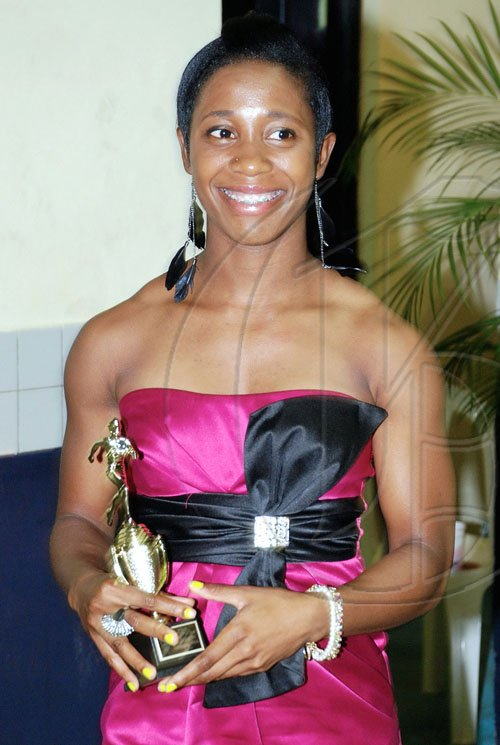 Colin Hamilton/freelance photographer Shelly-Ann Fraser shows her award for outstanding performance during UTECH Annual Sports Awards Ceremony at the Alfred Sangster Auditorium on Thursday February 11, 2010.