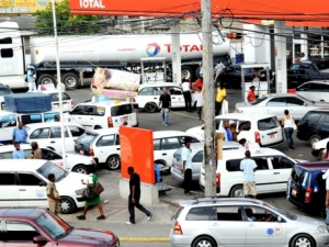 Taxi operators parked at a gas station in the Corporate Area- file photo.